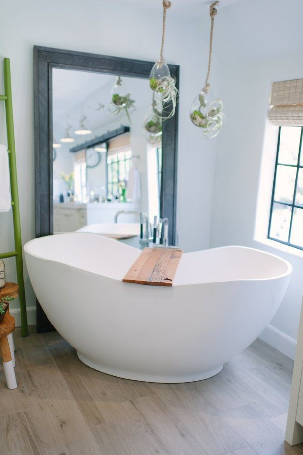Beautiful tub with bamboo shades in the background