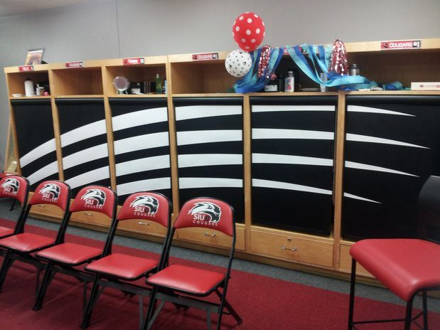 Lockers with roller shades showing team logo