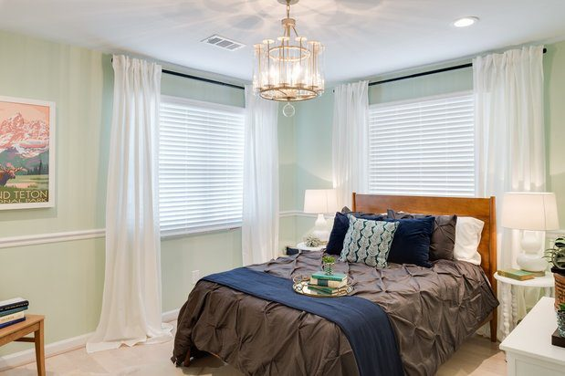 Home Free light green bedroom with faux wood blinds