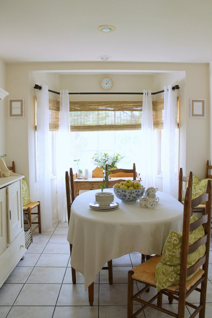 beautiful kitchen window treatment with bamboo shades and sheers