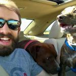 Kami and Maverick Enjoy a Car Ride with Their Owner, Ethan
