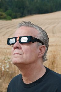 Man wearing eclipse glasses