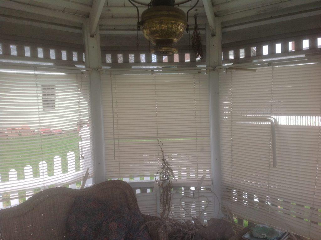 winter ravaged blinds in gazebo