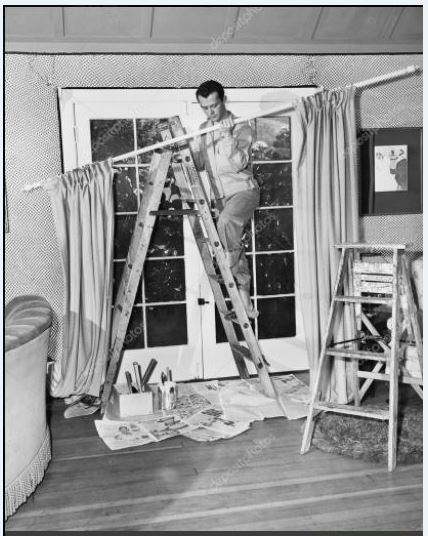 A dad hanging curtains in the 1950's!