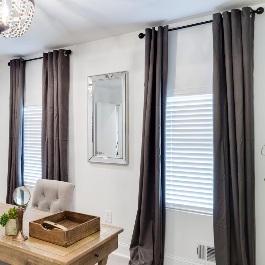 We love the look of darker drapery with our lighter colored real wood window blinds!