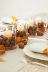 Fill Empty Space Around Candles With Nuts for a Fall Themed Tablescape