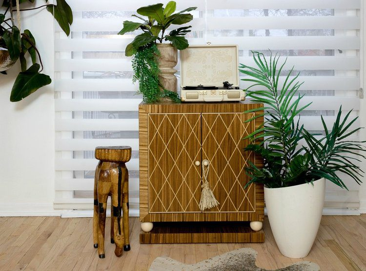Zebra Roller Shades over Sliding Glass Patio Door Behind Wood Cabinet with Record Player