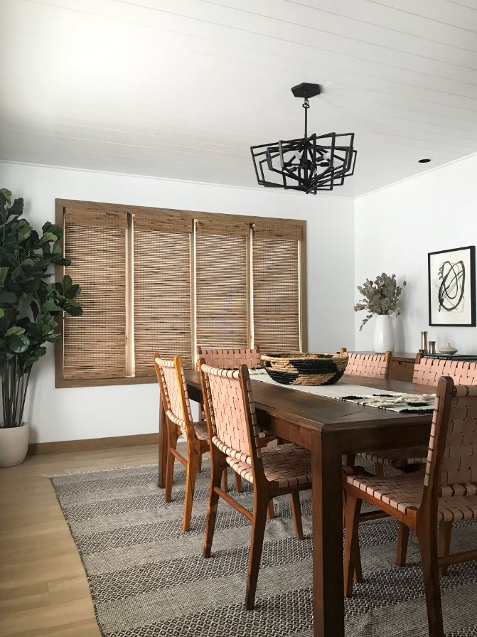 New modern dining space with premier woven wood shades in quince from Select Blinds