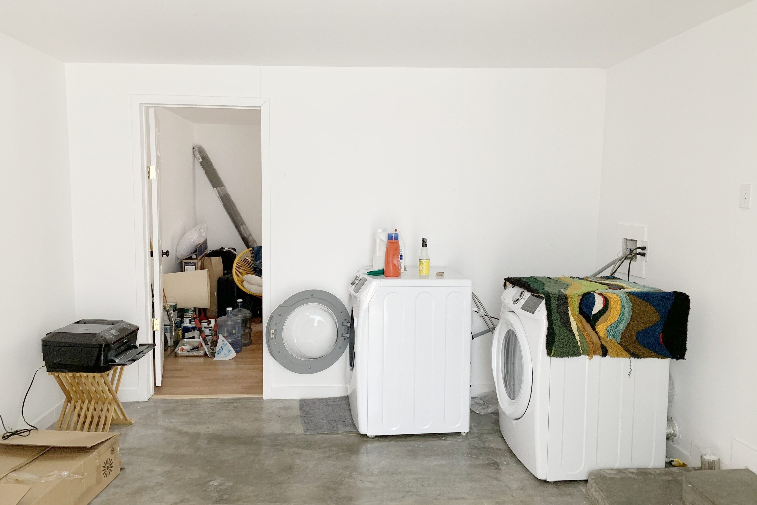 Unfinished White Laundry Room Before Makeover