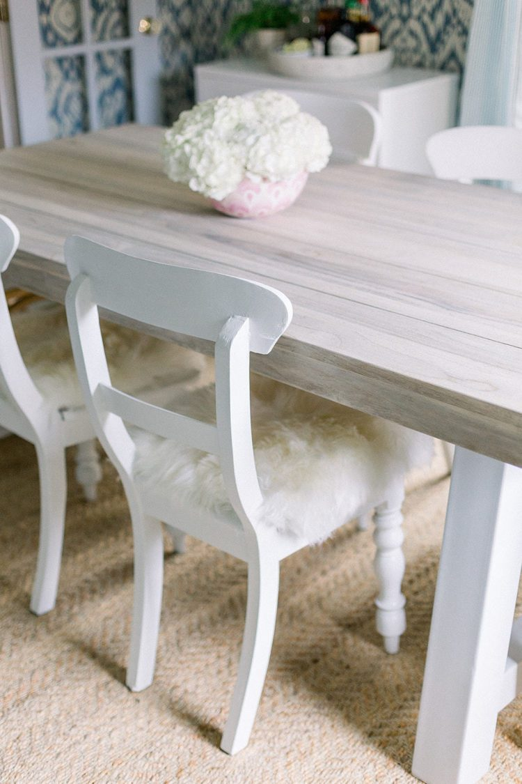 side chairs with sheepskin covers at wooden dining room table | Photo Credit Madison Rae Photography