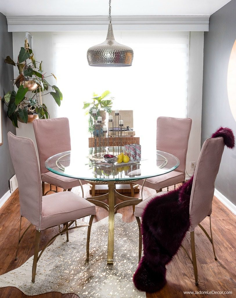 Bright dining room with pink chairs and wood floor