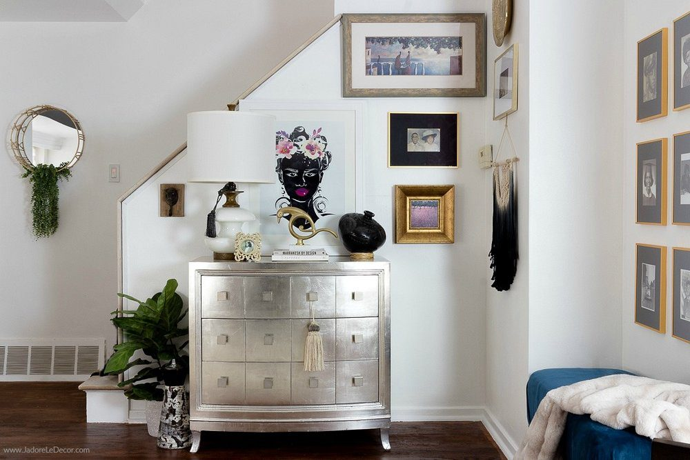 Wall art and Home Decor Scattered Among White Walls of Recently Remodeled Room