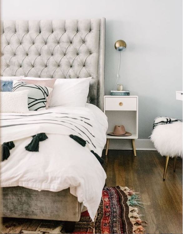 Boho bedroom design with white and grey furniture, nightstand and bedding photo by Jasmine Pulley