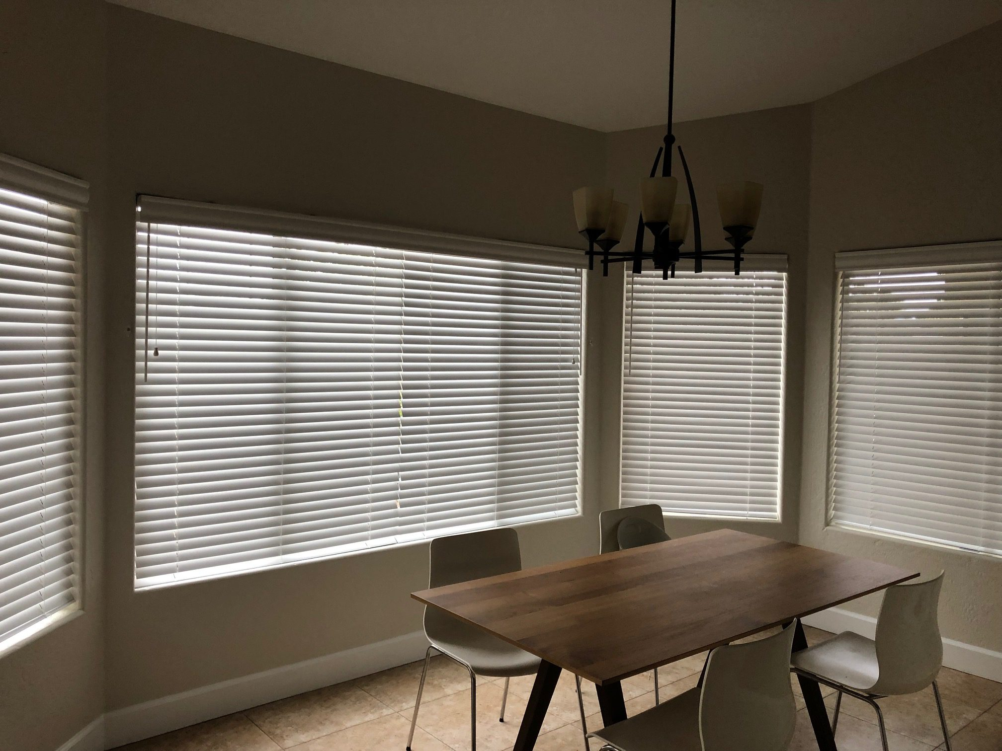 Premier 2 inch Wood Blinds in Ultra White in customer dining room