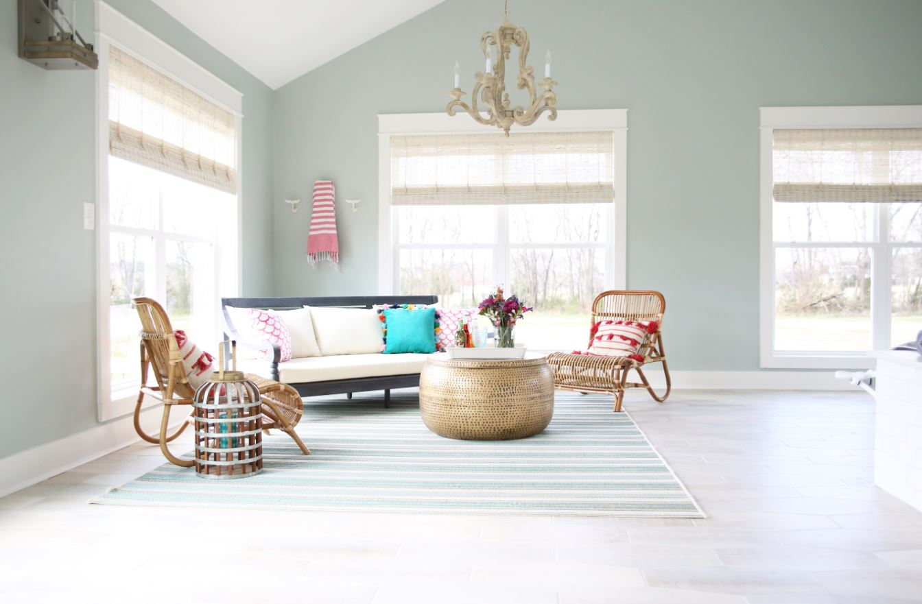 colorful corner seating area featuring Select Blinds Designer Series Woven Wood Shades in color Nassau