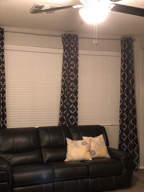 2 inch Premium Faux Wood Blinds in White Smooth from Select Blinds layered with geometric drapes in dining room