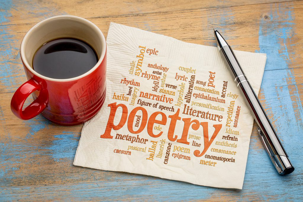 Cup of coffee and writing pen on napkin with poetry terms