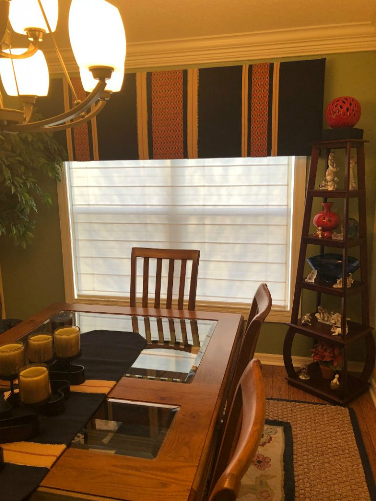 White Select Blinds motorized roman shades under custom cornice