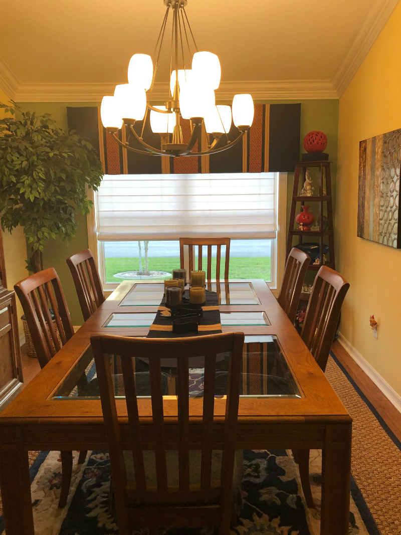 Long Wood Dining Room Table Under White Roman Shades