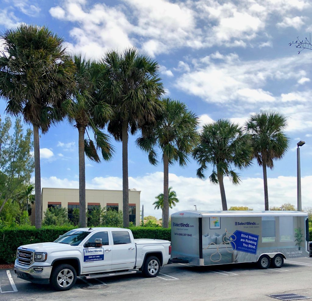 Select Blinds truck and trailer in front of palm trees in Florida