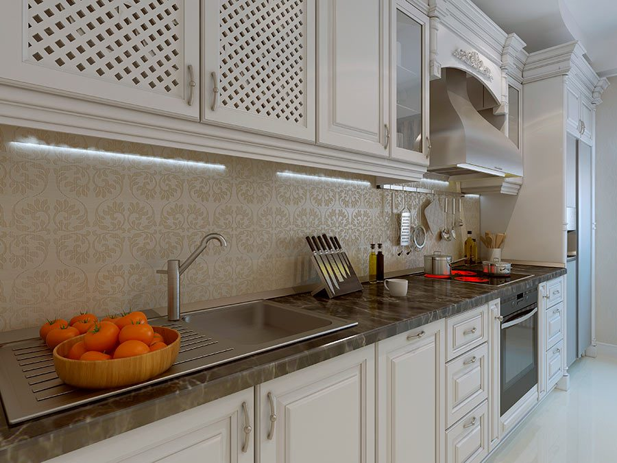 Granite kitchen counter top leading to stainless steel range hood
