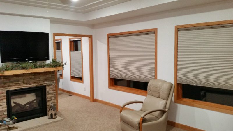 Row of windows covered with white blinds in home