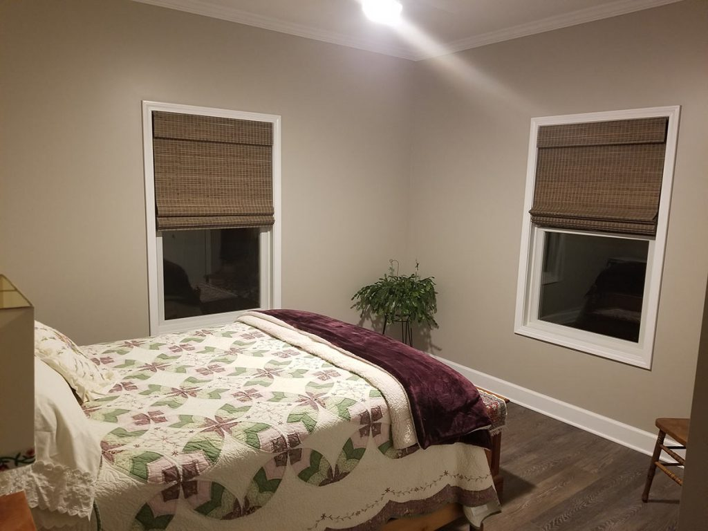 Bamboo shades complete the look of this bedroom.