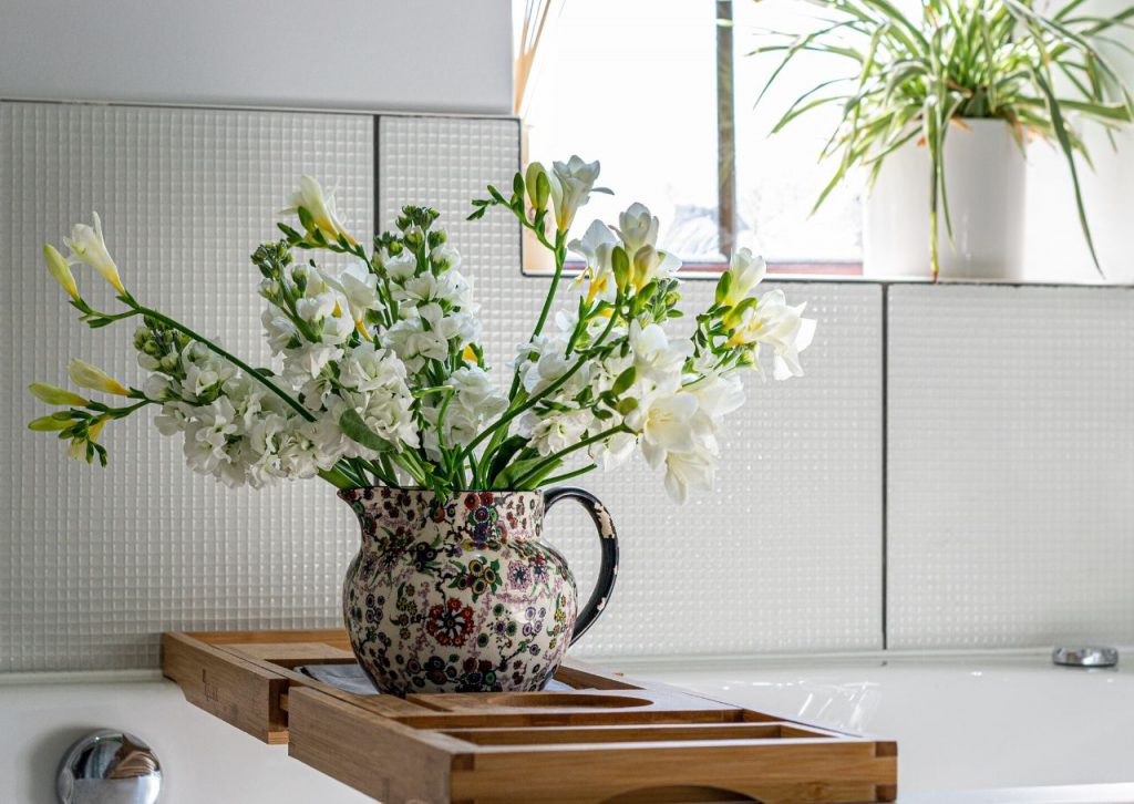 Adding real or fake flowers to your home showcases the beauty of nature.