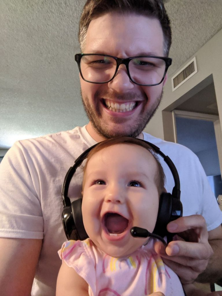 Excited baby wears a headset.