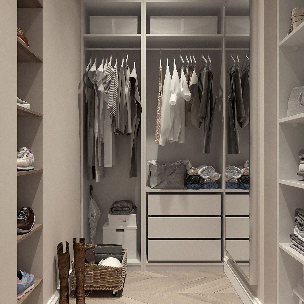 Highly organized closet in shades of white and cream.