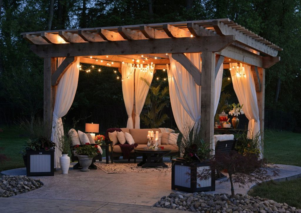 Outdoor patio with string lights and comfortable seating.