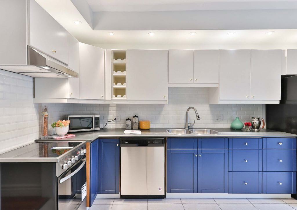 Blue kitchen cabinets add a pop of color to your space.