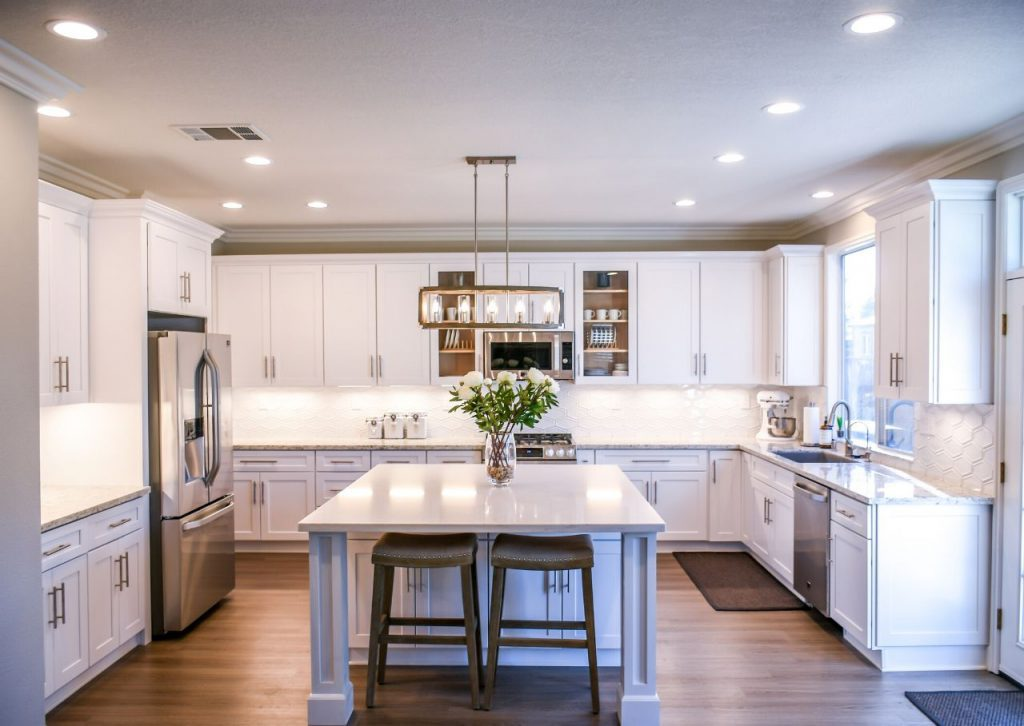 Beautiful and bright finished kitchen with white cabinets.