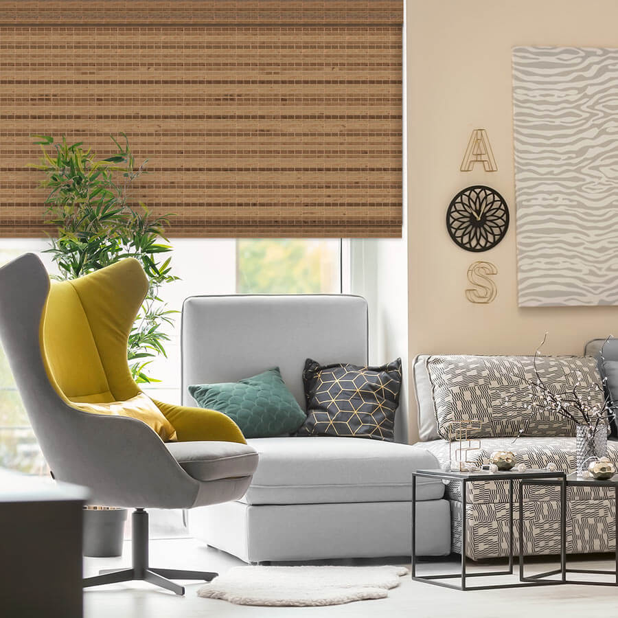 Bamboo woven wood shades behind a grey chair.