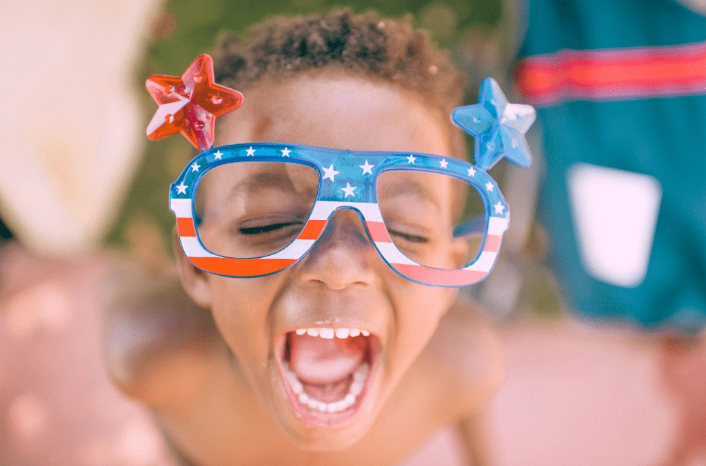 Kid with funny 4th of July goggles on