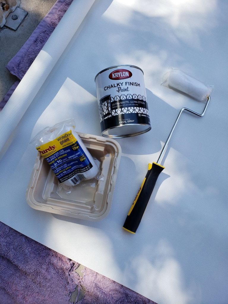 Paint and roller supplies to make a retractable chalkboard.