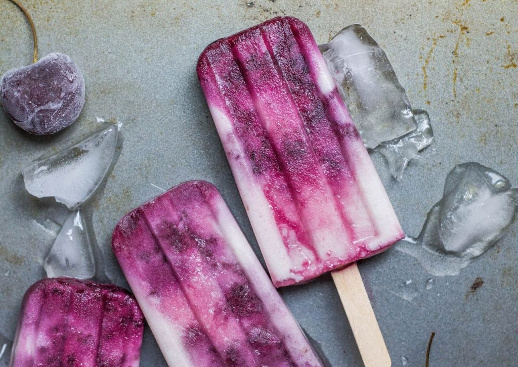 Homemade cherry and coconut popsicles.