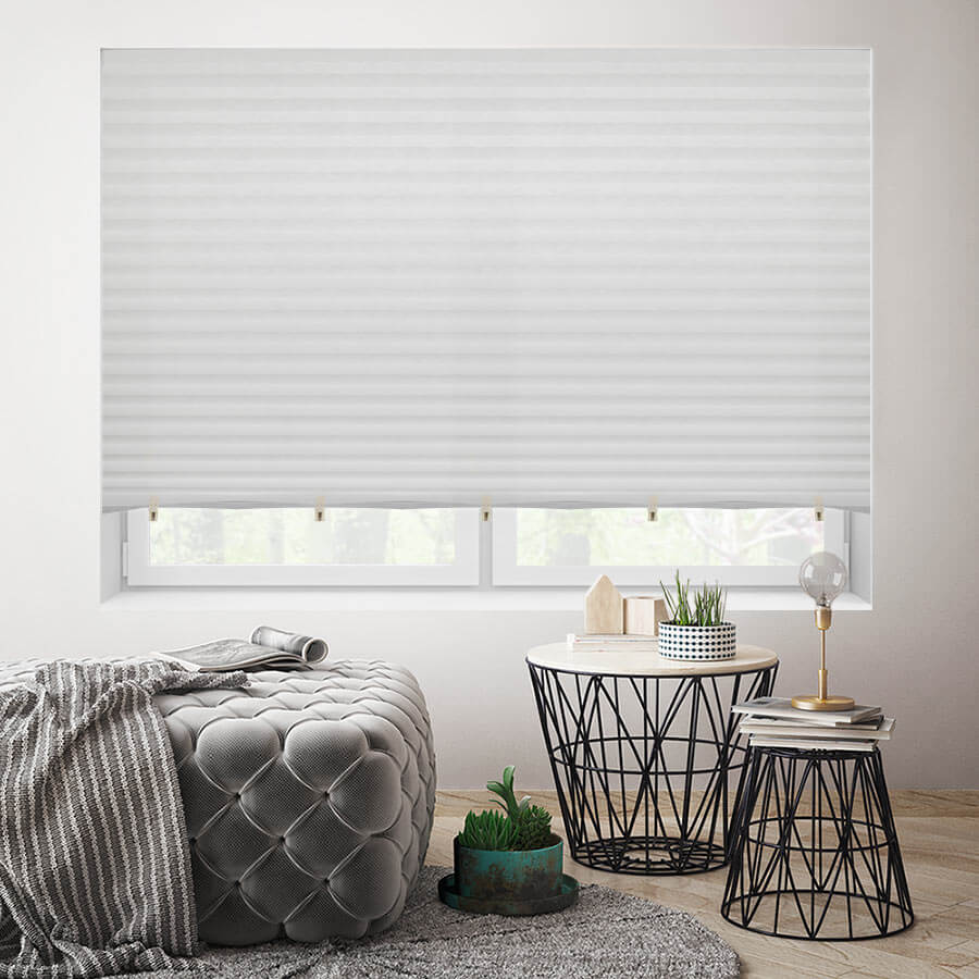 White, light filtering temporary paper shades.