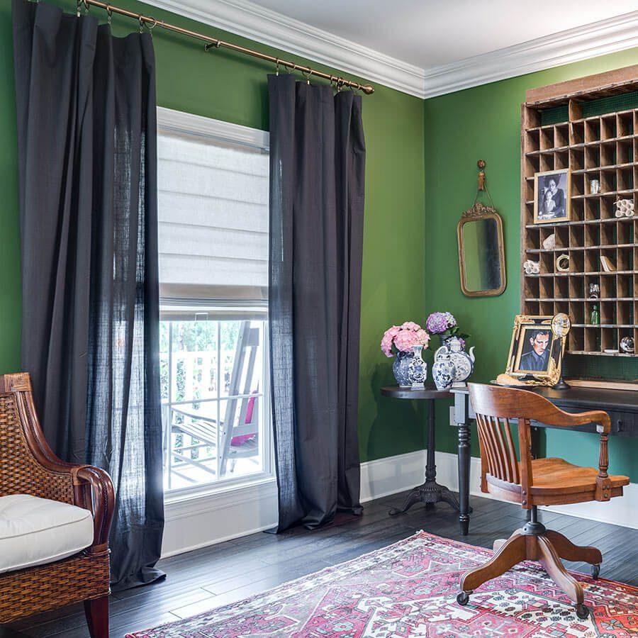 Roman shades in living room windows.