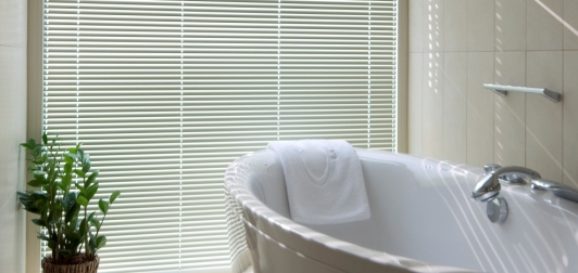Our 1 inch faux wood blinds do well against humidity and will give your bathroom an elegant look.