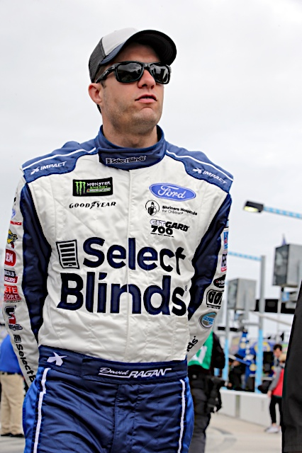 David Ragan from Front Row Motorsports wearing Select Blinds Firesuit