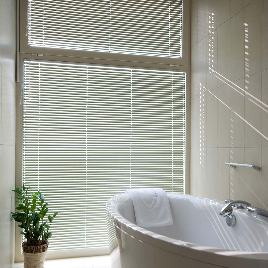 These 1 Inch Aluminum Mini Blinds won't fade and are water resistant, making them a perfect fit for any bathroom!