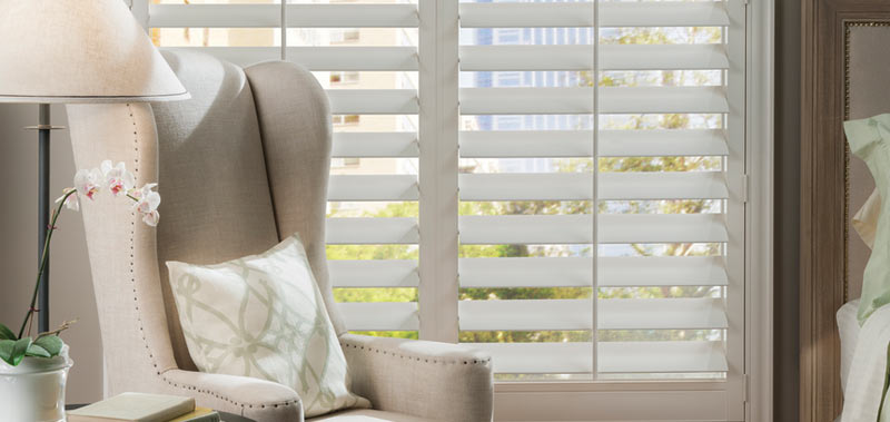 For a more traditional feel consider these Faux Wood French Door Shutters as your glass door window coverings.